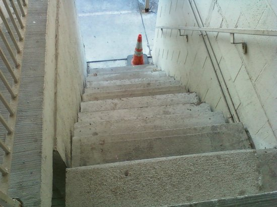 Limited Inn: caution cone on the stairs
