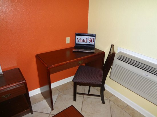Motel 90: Desk/work area with lamp and electrical outlet at desk level