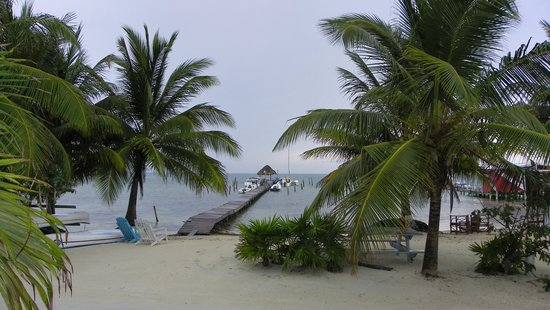 Costa Maya Beach Cabanas: View of beach and dock with the only Palapa that is that far into the water.