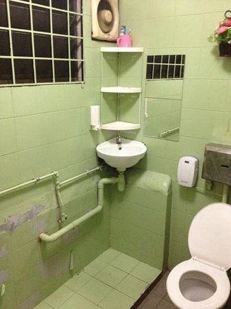 Feel At Home Hostel: this is one of the bathrooms, toilet with a shower