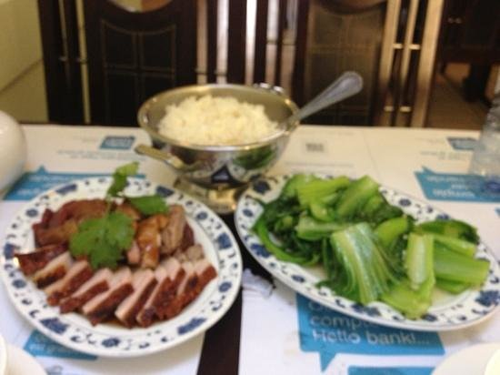 Hong Kong Delight: fried duck, white rice and bok choi