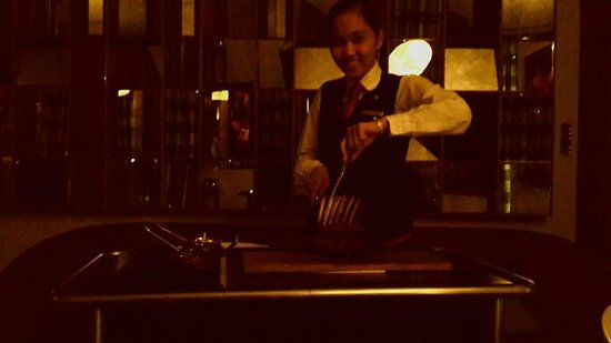 Astor Grill at the St. Regis Doha: Roselle cutting the lamb