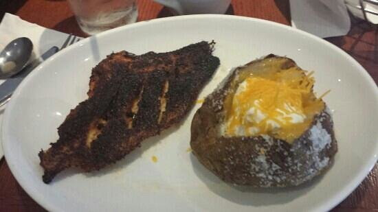 Red Lobster: blackened catfish and baked potato. Fish is burnt and I'm glad I like sour cream and cheese beca