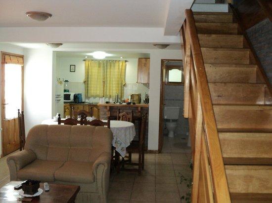 Patagonia Apart: vista desde el living de la cocina/comedor - baño de servicio y escalera a planta alta