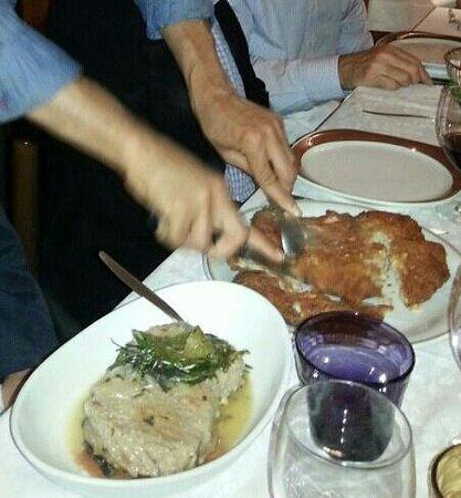 ... da Arturo: Steak with white wine sauce (left) pork chop-yum!- (right