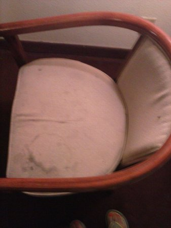 Country Hearth Inn Athens: Broken & badly stained chair (both chairs look like that)