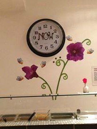 Vega Fairfood: The wall behind the buffet - it's cute! - and the clock.  What time is it?  It's NOW.