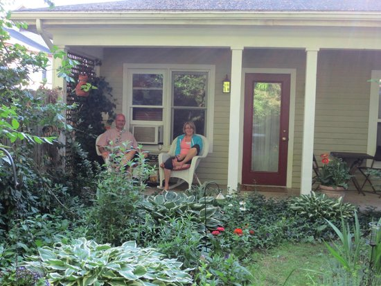 Hidden Garden Cottages & Suites: Relaxing on the porch of the Orleans cottage.