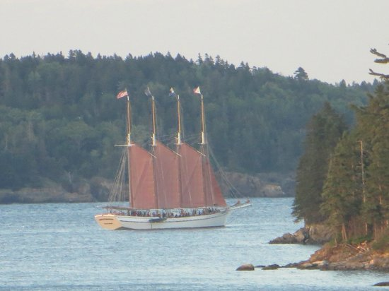 """Atlantic Oceanside Hotel and Event Center: VIEW FROM OUR DECK """"RED SAILS IN THE SUNSET"""""""