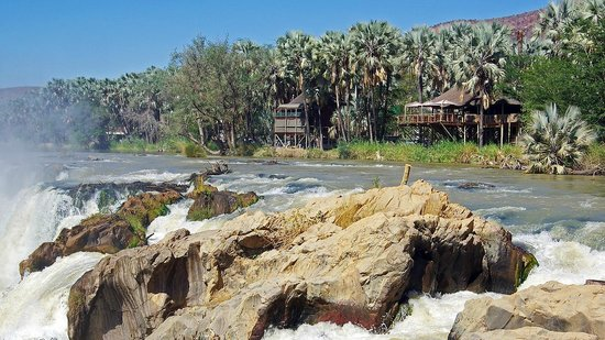 Epupa Falls Lodge: The restaurant and one of the chalets as seen from the falls.