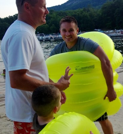 Rumbling Bald Resort on Lake Lure: Every kids needs a $6 tube for beach and lazy river pool fun. Someone has to do the carrying of
