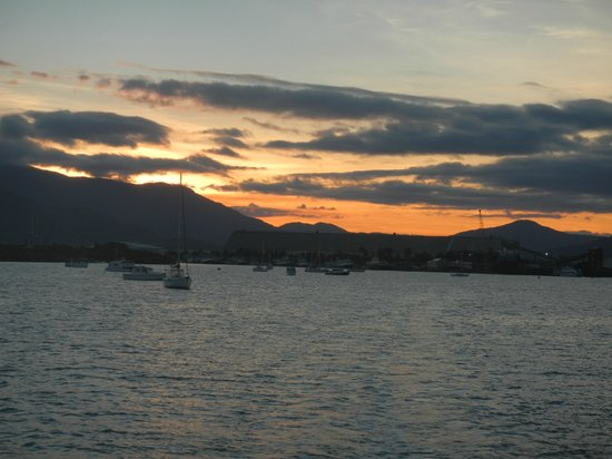 Cairns Harbour Cruises : Sunset and looking back towards Cairns.