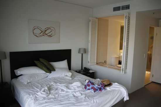 Cairns Luxury Apartments - Harbourlights complex : Bedroom looking into bathroom