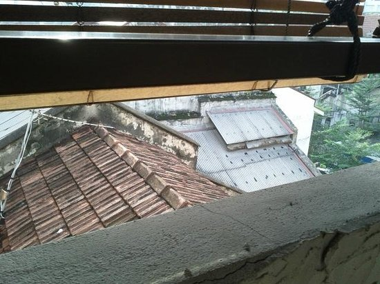 Anggun Boutique Hotel: one view of tile rooftops from Anggun's rooftop restaurant