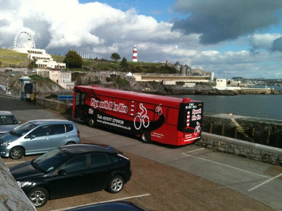 Plymouth Bike Hire: The Bike Bus and a moody sky over Plymouth Hoe.  Bikes ready for hire.