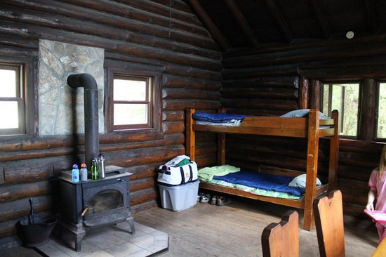 Carp Lake, MI: 2 sets of bunk beds, wood burning stove, dining table/chairs, and shelving