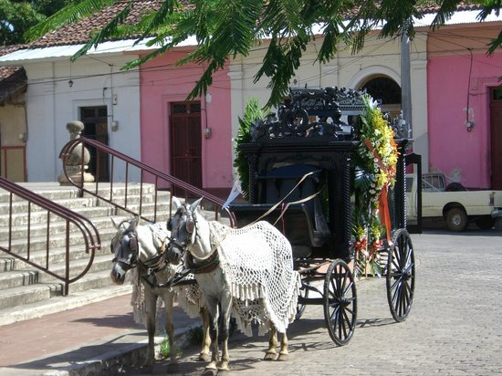 Guadalupe Church: Horse-drawn hearse in front of church