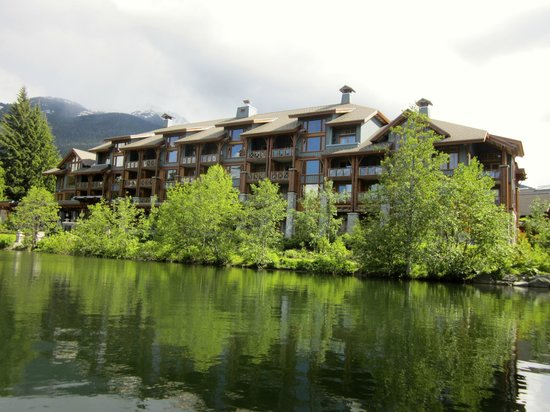 Nita Lake Lodge: View from kayak. The running trail that goes to the village is between the building and lake.