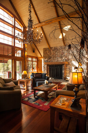 Stowe Meadows: Guest Den - First floor level featuring 2 story fireplace, mountain views and interior 2-story w