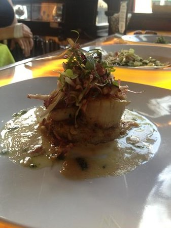 Watermark: Pan Seared Sea Scallops with a lyonnaise potato cake and a vanilla bean ber blanc. top it off wi