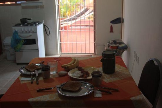 Nos Krusero Apartments: our breakfast with a partial view of the kitchen, dining and sitting room (couch behind the came