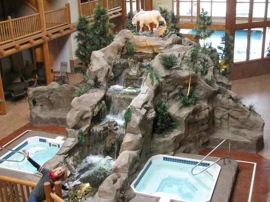 C'mon Inn Hotel & Suites: These are how the hot tubs inside look and the waterfall leads to a pool with fish in it!