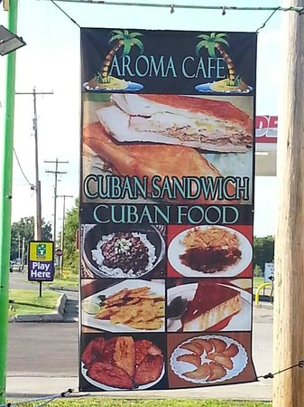 Aroma Cafe: Large sign in the parking lot to greet guests