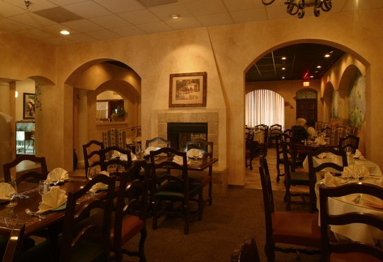 This Is The Dining Room With A Cozy Fireplace