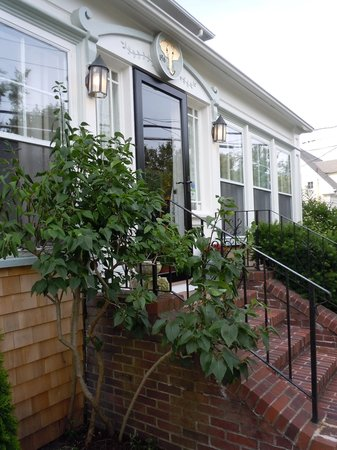 The Elephant Walk Inn: Front entrance surrounded by beautiful plantings