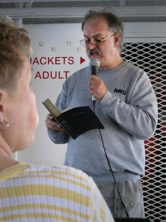 Star Line Mackinac Island Ferry: Rev. Erik Alsgaard from St. Ignace UMC reads a Bible passage as ferry approaches Mighty Mac.