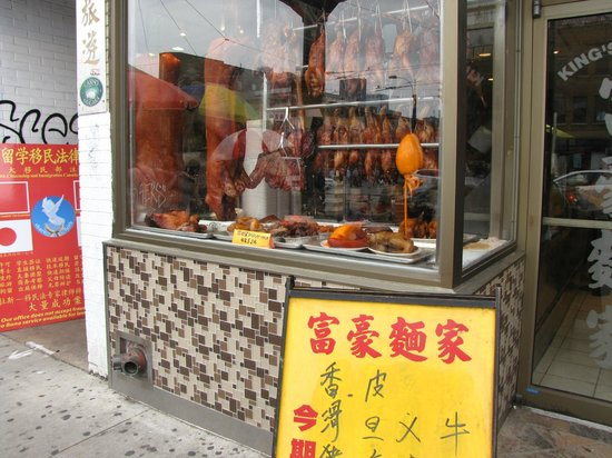 Toronto Urban Adventures : Not sure what kind of meat was hanging in the window?