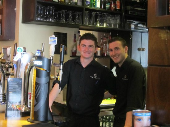 The Cellar Bar and Restaurant: The lads at the bar....they made us REAL Iced Tea!