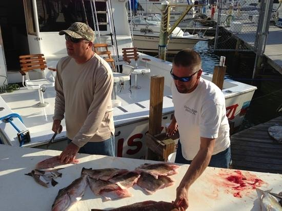 Daisy Mae Fishing Charters: Captain Eric & Tim cutting up our catch.
