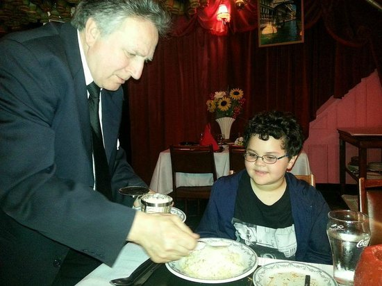 Luciano's: teaching pasta twirling to my sone