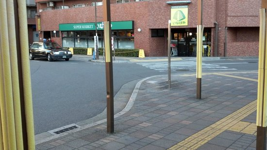 Shinsayama Hotel : This grocery store is across the tracks.