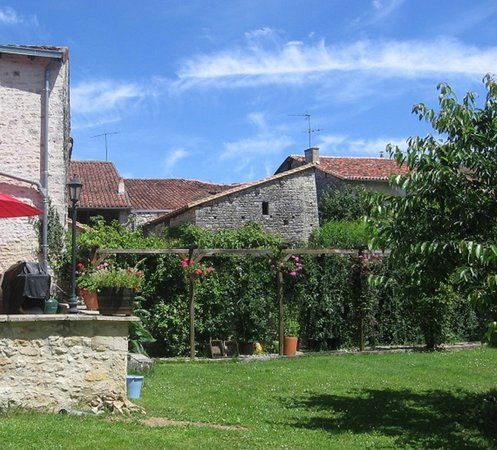 Les Bruyeres: Part of the rear garden and surrounding buildings