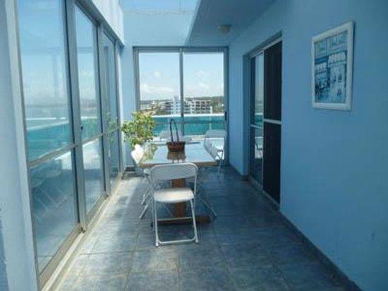 Apart Hotel Punta Azul: comedor vidriado penthouse