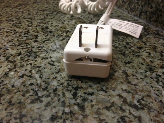 Crowne Plaza Memphis East: Broken hairdryer plug.