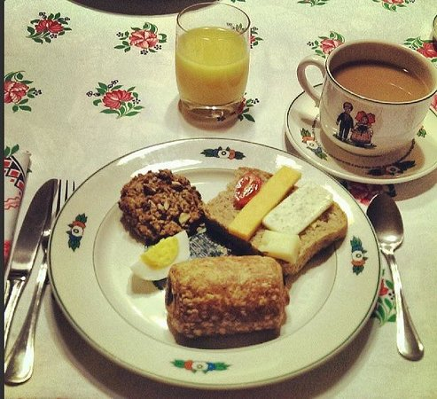 La Petite France: Homemade bread, chocolate croissants, eggs and a breakfast cookie along with adorable flatwear
