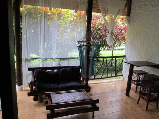 Villas Río Mar: View of the patio/front porch from room. One could sway in the hammock and relax.