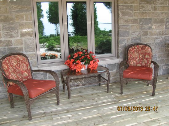 Acres on the Lake Bed and Breakfast: Chairs for the Lakefront suite outside the window overlooking the water