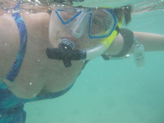Me with my Aaron's Dive Shop snorkel, mask & waterproof arm pouch.