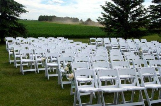 Barn Loft Inn : Chairs in front of alter, tent to left of chairs and wheat field at the back of the chairs.