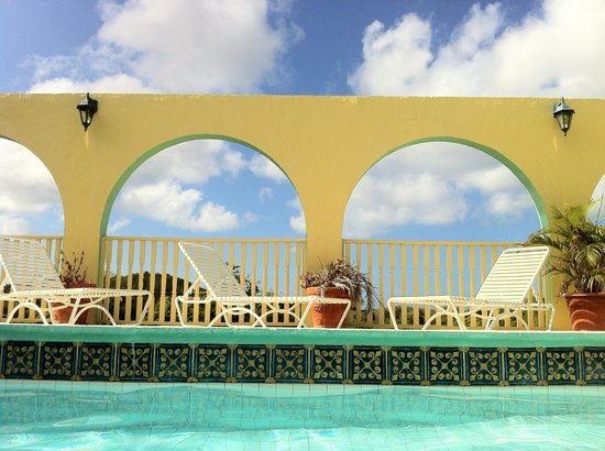 Carringtons Inn St. Croix: View of arches and blue sky from Carringtons pool