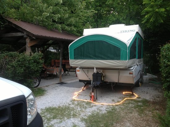 Deep Creek Tube Center & Campground: Site 26 not on river, but..near bath house separated  by privacy shrub, covered picnic table,  l