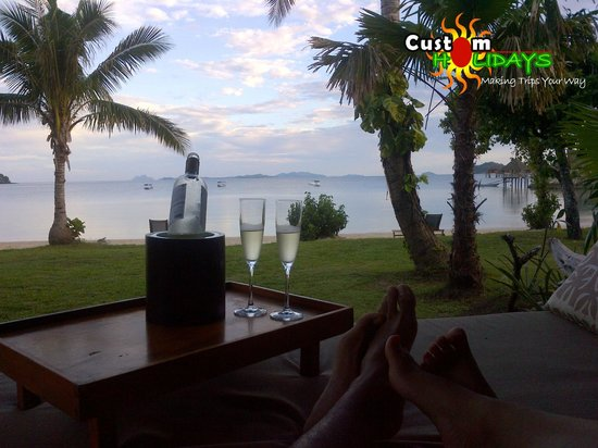 Likuliku Lagoon Resort: Relaxing on our sunbeds with a bottle of bubbly!