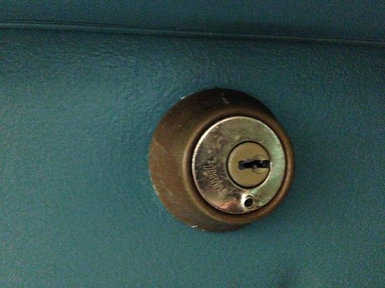 Flagship Inn And Suites: Drill hole on front door lock