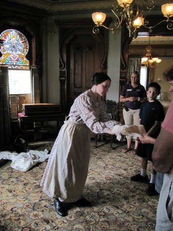 "Hackley and Hume Historic Site: The ""maid"" instructs the visitors on dusting"