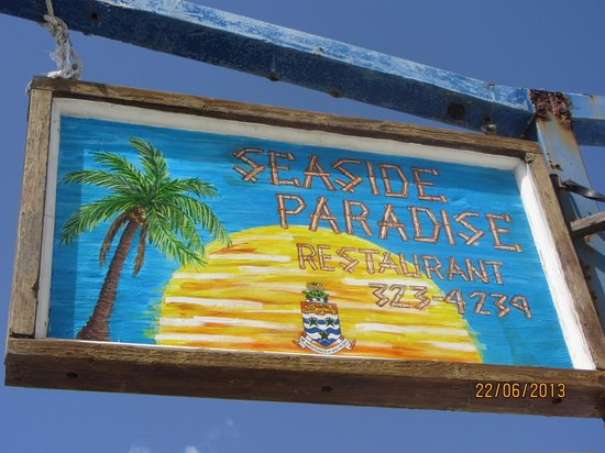 Seaside Paradise Restaurant: Sign by the road on your way through Bodden Town