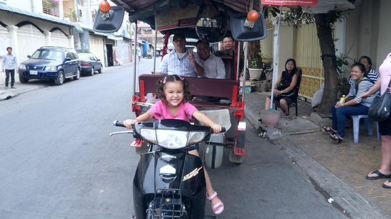 Hang Neak Hotel: my daughter in front of hotel with friendly tuk tuk driver.